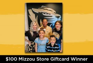 """Photo of a family of five smiling at the camera with text below in white """"$100 Mizzou Store Giftcard Winner"""""""