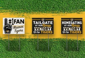 "Graphic showing three yard signs on a green grass background. Sign one text ""#1 fan Missouri Tigers"", sign two text ""Tailgate at our house victory for the tigers"", sign three text ""homegating at our house victory for the tigers""."