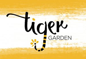 """Gold background with hand drawn text """"Tiger Garden"""""""