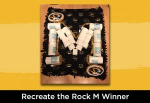 """Photo of items forming a """"M"""" with text below in white """"Recreate the Rock M Winner"""""""