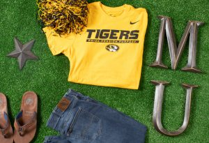 "Photo of gold shirt with Nike symbol and ""Tigers® Pride. Passion. Purpose"" and Missouri Tigers Atheltic Tiger head."