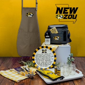 Photo of mizzou branded products including an apron, plate, cooler.