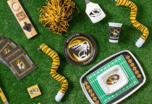 Photo of Mizzou branded party items including dip plate, paper plates, napkins and cups.