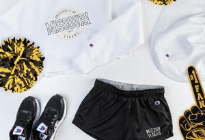 "Photo of white ""Missouri"" cropped top and ""Mizzou Tigers"" Champion shorts."